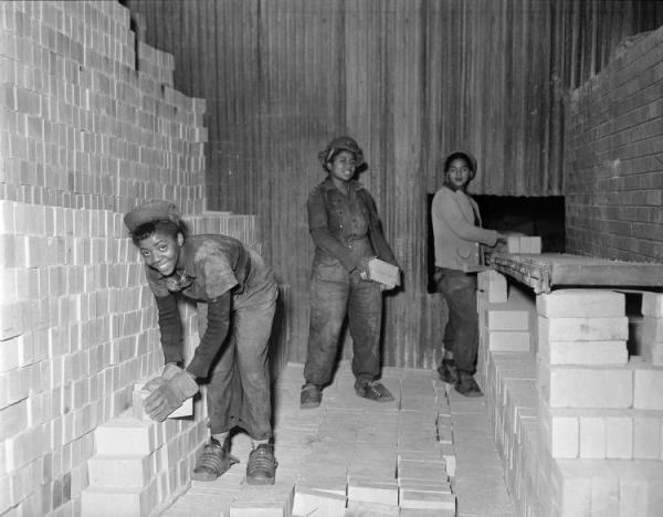 African-American Women Employees at Carrie Furnace Learning Masonry Skills.