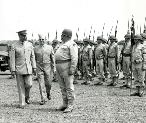 Troops at attention as the Major General walks by for inspection.