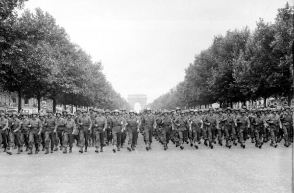 he 28th Infantry Division marching in front of the Champs Elysee in Paris, France. August 29, 1944.
