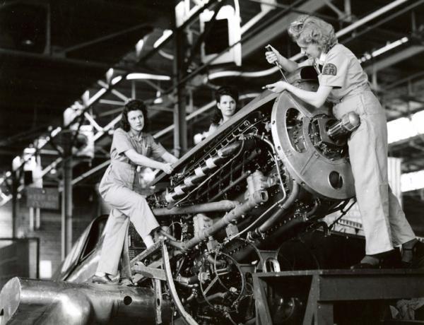 Three women work on Machines.
