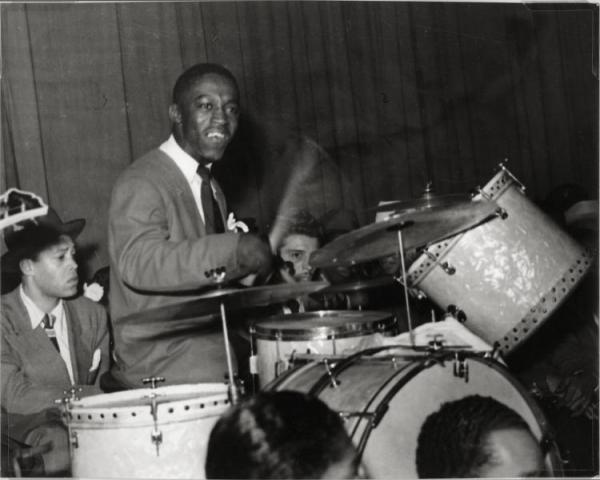 Art Blakey playing drums, with Leo Parker, John Jackson, and Sonny Stitt playing saxophones, in the Billy Eckstine Band.