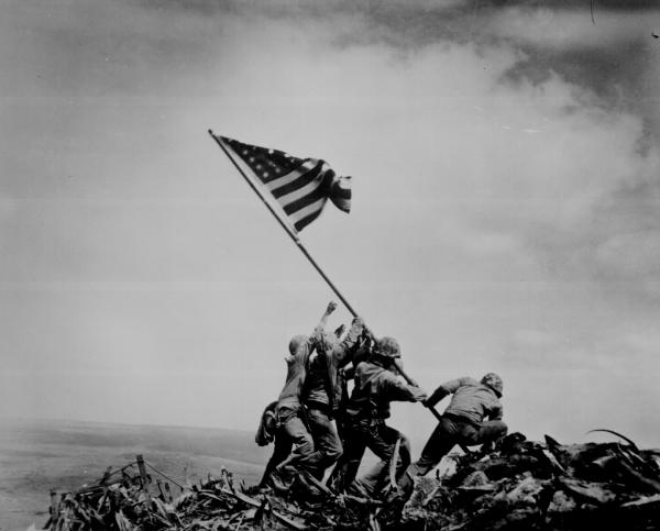 Black and white image of men raising the American flag on Iwo Jima
