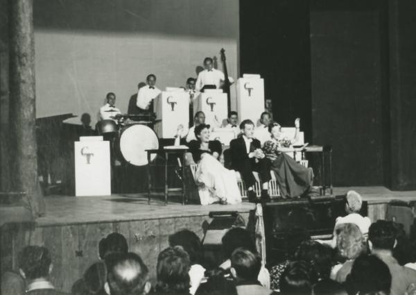 Renovated Social Hall interior of the Tamiment theatre, 1939, with Danny Kaye and Imogene Coca in front of the Tamiment Orchestra.