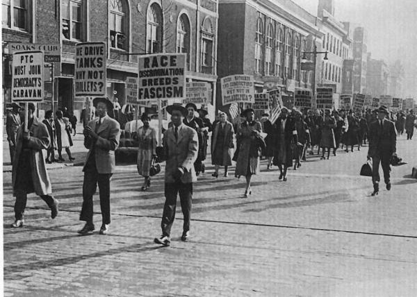 African American march and carry protest signs.