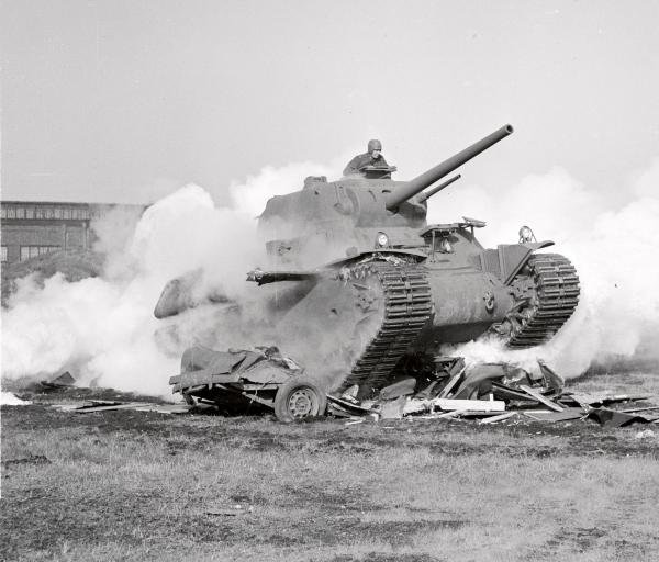 A 60-ton M-1 type tank crushing a truck.