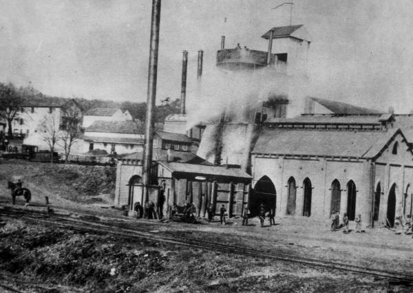 Image of the furnace complex and workers.