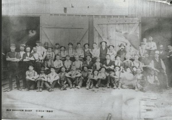 Workers in front of the old hammer shop, 1880.
