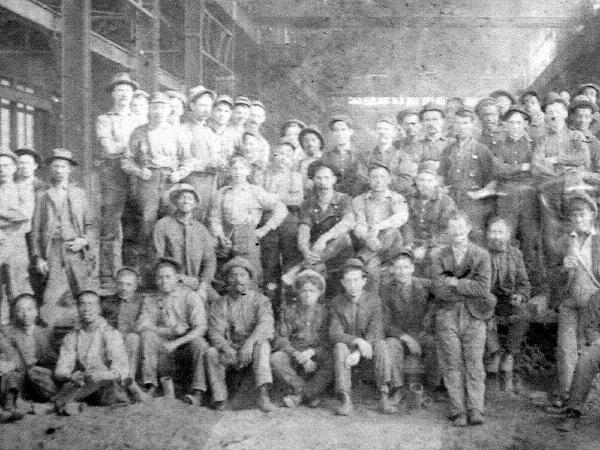 Group photograph of rugged iron men.