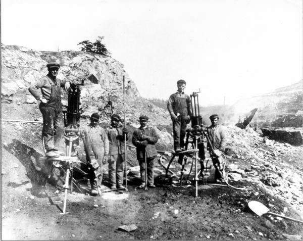 Image of workers standing at the Ore.