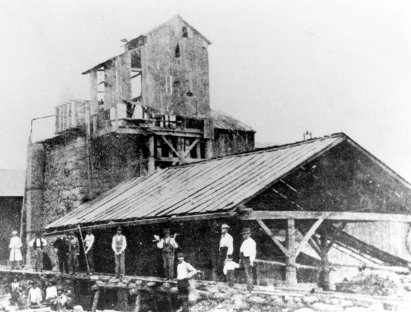 Juniata Iron Furnace and workers with tools.