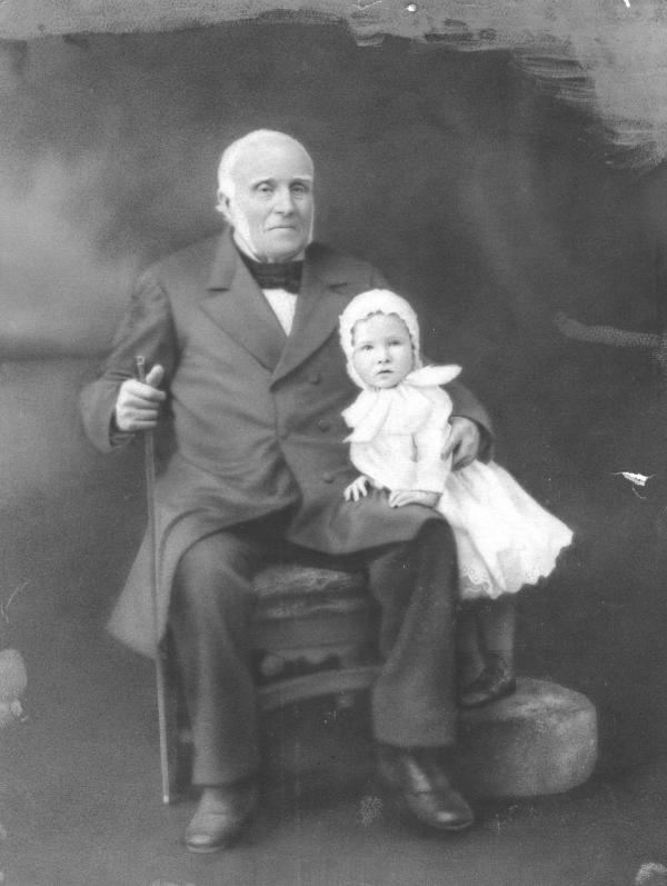 Formal Portrait of Watts and his grandchild