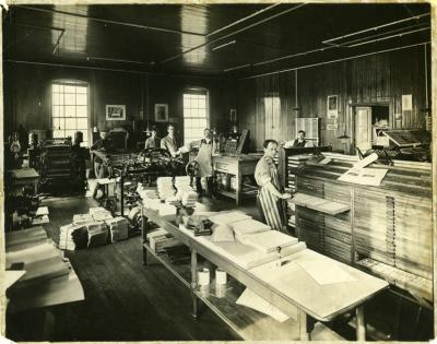 Hershey Press Company; Interior; workers with printing equipment and machinery; signs visible on walls, ca 1911-1915.