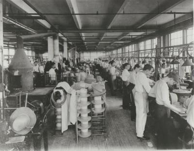 Stetson Hat Company employees finish hats.