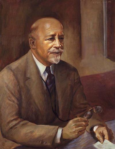 Oil on canvas of DuBois seated, facing right, wearing a brown suit and tie.