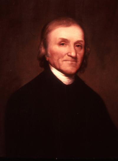 Oil on canvas on Joseph Priestly wearing a dark suit with a white collar.