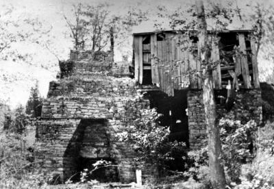 Black and white image of the remains of the furnace
