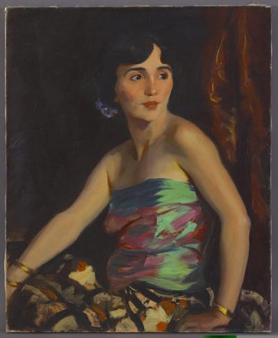 Oil on canvas of a Spanish dancer seated and posing while wearing a colorful, shoulder baring dress.