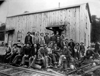 Lumber workers were housed in temporary wooden buildings that could be dismantled and moved as the center of logging operations changed location.