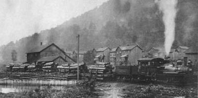 Logs arrive by train to the sawmill at Laquin, Pennsylvania, in 1880. The town of Laquin, like others in the state, sprung up around the logging industry. By 1941, the big trees were long gone and the town was abandoned.