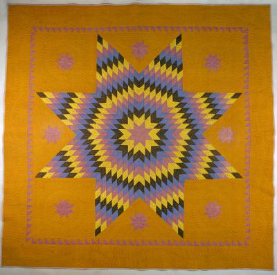 A quilt depicting the Star of Bethlehem pattern.