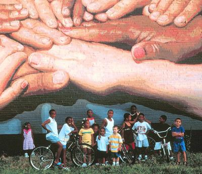 The grouped hands of various colors is the theme of this mural.