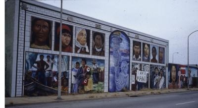This mural traces the history of immigration in the United States and includes important figures in the civil rights movement who worked to bring harmony amongst all the different races and ethnic backgrounds making up this country.  The faces of many different cultures are represented in this mural.