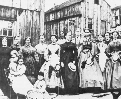 Twelve women and three girls dressed in