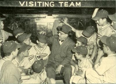 Black and white baseball card of the Pennsylvania Championship team from Monongahela and Branch Rickey in the dugout.