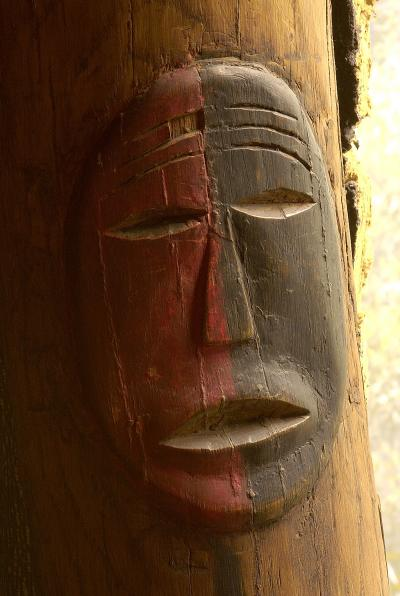 This carved and painted wood post replicates carvings found in the Big House. The dual color scheme, red and black, is symbolic of both good and evil and of life and death.