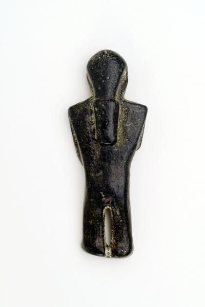 Carved steatite human effigy, reverse.