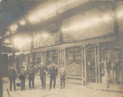 The Open Hearth Furnace crew (including children) at the Jones and Laughlin Steel Company,  1900.