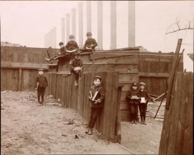 The earliest image to juxtapose children with Pittsburgh's smokestacks. Gelatin silver print.