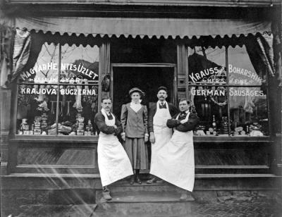 Butcher shop workers and shoppers pose outside of two Cambria City butcher shops. Each shop served different ethnic groups.
