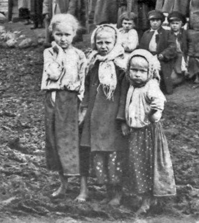 There are three children in the foreground and three in the background.