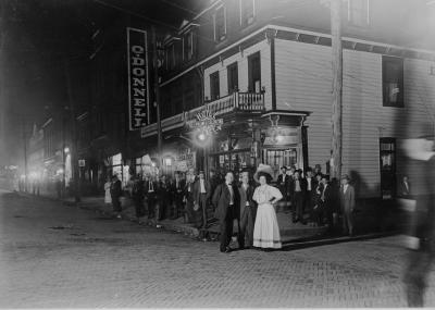 Image of townspeople along the street.