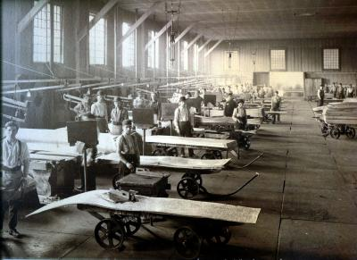 Workers with sample carts, inside of the American Sheet and Tin Plate Company, Vandergrift, 1913.
