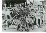 Group photograph of workers with tools.
