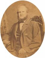 Portrait of John Armstrong Wright sitting.