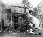 Hopewell Furnace as it appeared in 1896. In the background from left to right are the furnace, bridge house, and open-sided shed on the furnace bank. In the foreground is the shell of the cast house.