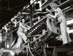 Three women work on Machines.'