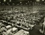 Huge interior factory image of workers.'