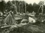 Image of tents, makeshift kitchens, and miners.'