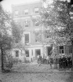 Group of people in front of home of Alexander Mitchell Palmer, after bomb explosion, 1919.