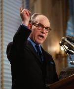"A color photograph of W.A. ""Tony"" Boyle, president of the United Mine Workers of America, gesturing during a two hour news conference at the National Press Club."