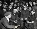 "Pennsylvania-Governor George H. Earle of Pennsylvania, circular light on his cap, is pictured with the 38 ""stay-down"" miners who have self-imprisoned themselves 1300 feet underground in the Number 8 mine of the Lehigh Navigation Coal Company."