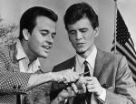 Dick Clark Showing Bobbie Rydell how to peel a potato