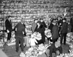 This photo shows the interior of its food distribution service and workers at the 103rd Engineer's Armory at Broad and Callowhill Streets.