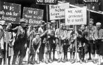 A group of children holding placards.