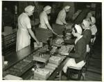 Production; wrapping department, Kiss; female employees; assembly line, women verifying weight of 2 pound boxes, 1936-1937'