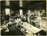 Hershey Press Company; Interior; workers with printing equipment and machinery; signs visible on walls, ca 1911-1915.'
